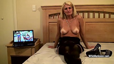 Mature sexy blonde promotes various..
