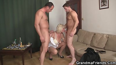 Two men bang sexy blonde grandma