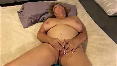 Horny busty mature lady masturbates