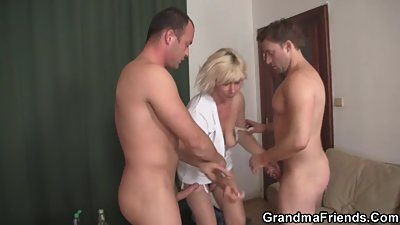 Hot blonde mommy swallows two cocks at..