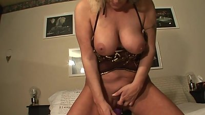 Kinky blonde mature slut playing with..