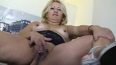 Horny blonde old lady playing about..