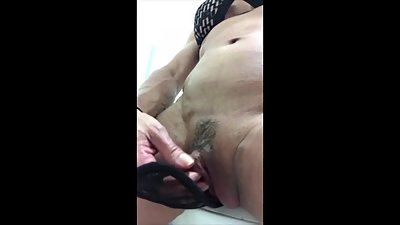 Mature rubbing her giant clit