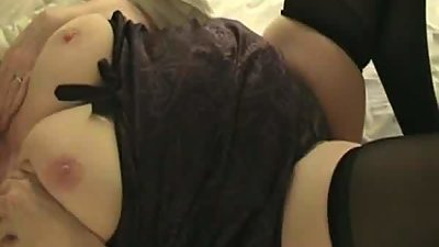 My wife in lingerie touching her big..