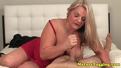 Busty mature sensually rubbing hard..