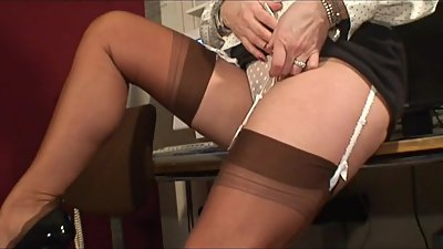 Sexy Stocking Teasing MILF in Busy..
