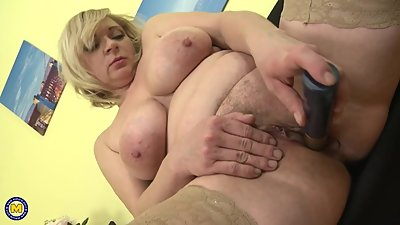 Lovely busty mature mom feeding her..