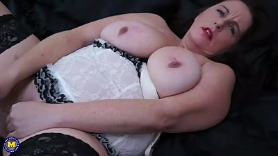Huge titted brunette mature sucks her..